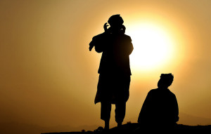 31-afghan-men-pray-on-hill