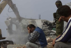 A-Palestinian-man-cant-look-as-his-home-is-demolished1
